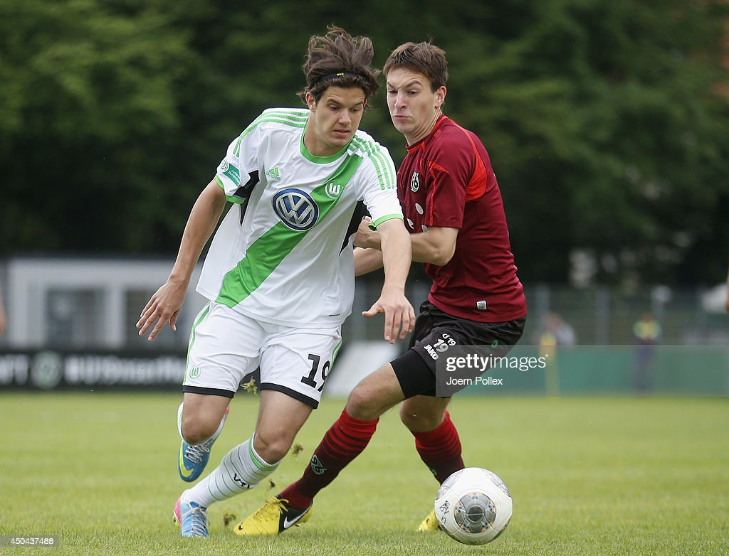 Fynn Arkenberg (R) of Hannover and Oskar Zawada of Wolfsburg compete for the ball during the A Juniors Bundesliga Semi Final at Beekestadium on June 11, 2014 in Hanover, Germany.