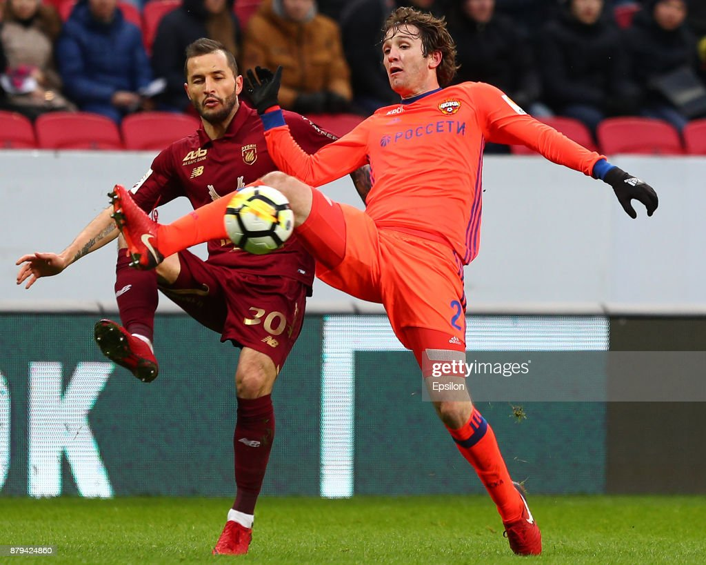 Fyodor Kudryashov (l) of FC Rubin Kazan vies for the ball with Mario Fernandes PFC CSKA Moscow during the Russian Premier League match between FC Rubin Kazan and PFC CSKA Moscow at Kazan Arena stadium on November 26, 2017 in Kazan, Russia.