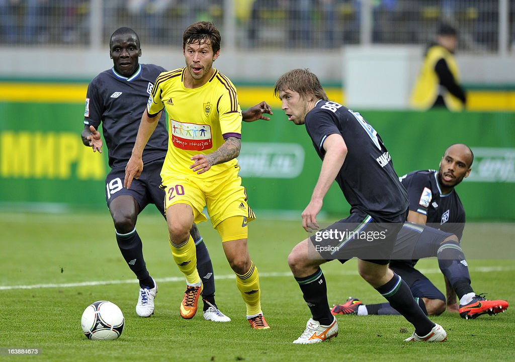 Fyodor Smolov of FC Anzhi Makhachkala is challenged by Benoit Angbwa, Dmitry Verkhovtsov and Steeve Joseph-Reinette of FC Krylia Sovetov Samara during the Russian Premier League match between FC Anzhi Makhachkala and FC Krylia Sovetov Samara at the Anzhi Arena Stadium on March 17, 2013 in Kaspiysk, Russia.