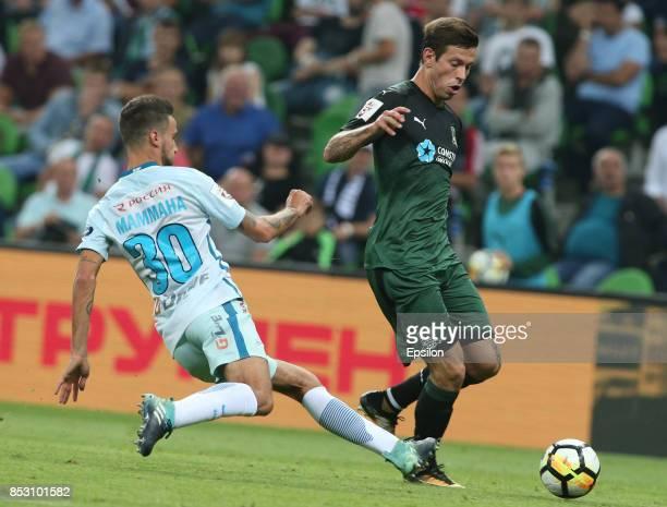Fyodor Smolov of FC Krasnodar is challenged by Emanuel Mammana of FC Zenit St Petersburg during the Russian Premier League match between FC Krasnodar...