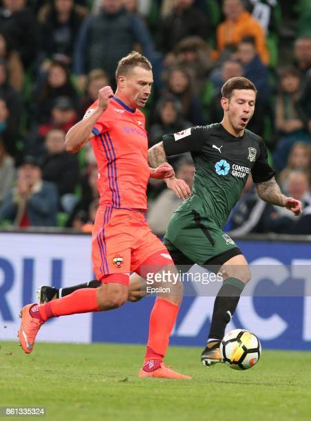 Fyodor Smolov of FC Krasnodar is challenged by Vasili Berezutski of FC CSKA Moscow during the Russian Premier League match between FC Krasnodar v FC...
