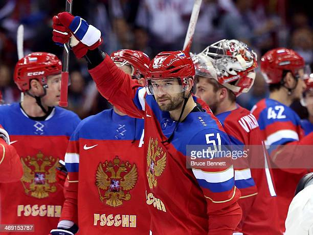 Fyodor Tyutin of Russia celebrates with teammates after defeating Slovenia 52 during the Men's Ice Hockey Preliminary Round Group A game on day six...