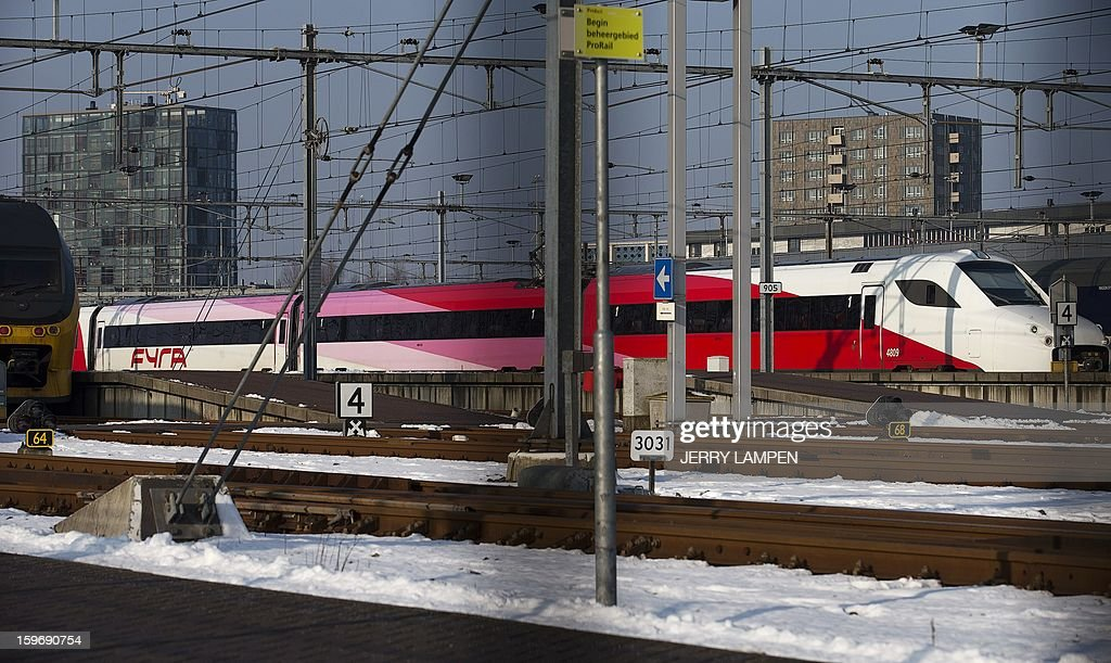 A Fyra train sits on January 18, 2013 in a shunting yard in Watergraafsmeer. The Fyra, a high-speed train service operating between Amsterdam and Brussels, did not operate on January 18 because the metal work underneath the train was damaged due to large ice blocks. And Belgium banned the Fyra from riding on its Belgium railways. AFP PHOTO / ANP / JERRY LAMPEN - netherlands out -