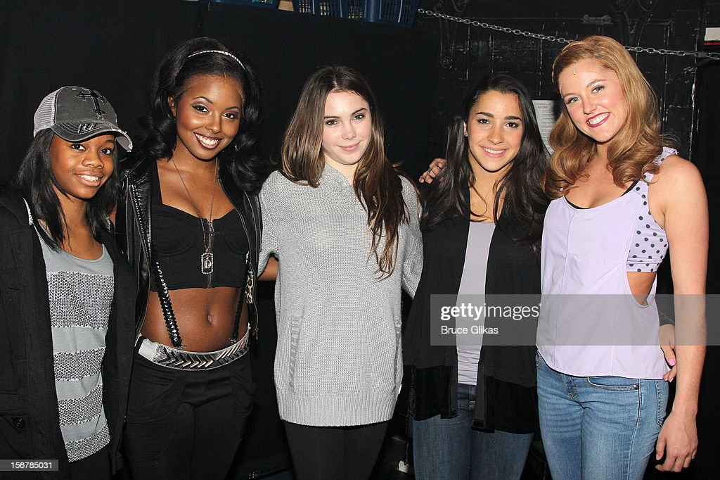 Gabby Douglas, Adrienne Warren, McKayla Maroney, Aly Raisman and Taylor Louderman pose backstage at the hit musical 'Bring It On' on Broadway at The St. James Theater on November 20, 2012 in New York City.