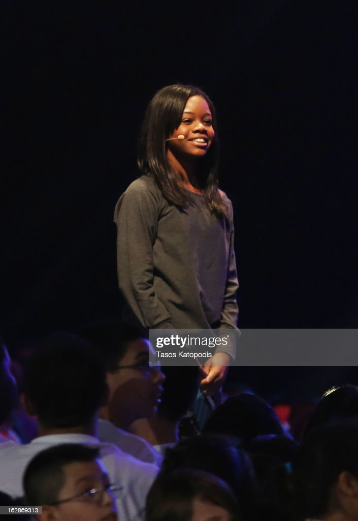 <a gi-track='captionPersonalityLinkClicked' href=/galleries/search?phrase=Gabby+Douglas&family=editorial&specificpeople=8465211 ng-click='$event.stopPropagation()'>Gabby Douglas</a> enters the stage at McCormick Place during a debut of a school exercise program February 28, 2013 in Chicago, Ililnois. Michelle Obama unveiled a new program called 'Let's Move Active Schools' to help schools create a physical activity programs for students
