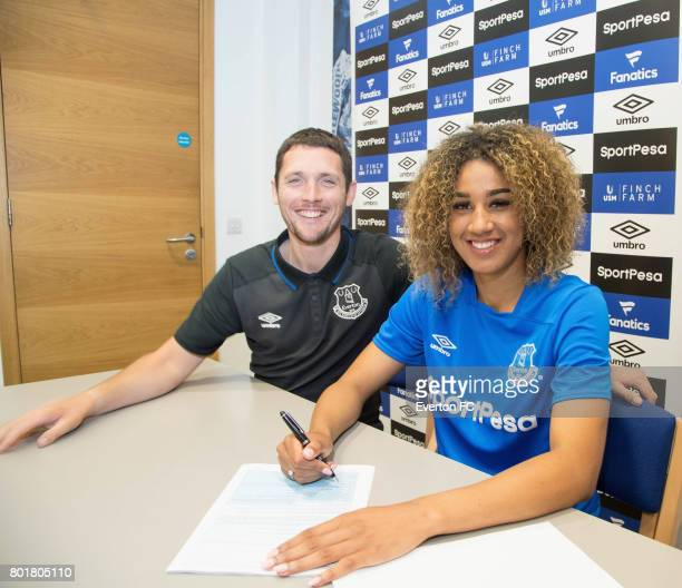 Gabby George of Everton Ladies poses for a photo with Everton Ladies manager Andy Spence after signing a fulltime contract with Everton Ladies at USM...