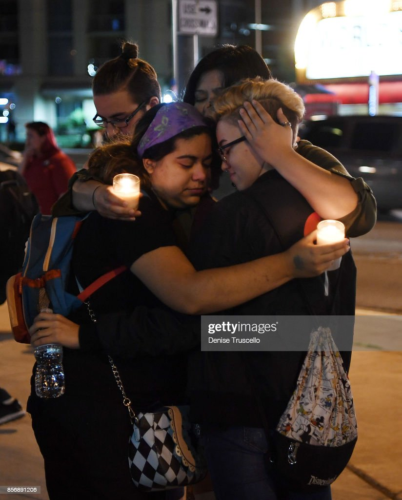 Gabby Phillips, Sam Alworth, Ana Preciado and Evan Dixon embrace during a vigil on the Las Vegas strip, for the victims of the Route 91 Harvest country music festival shootings on October 2, 2017 in Las Vegas, Nevada. Lone gunman Stephan Paddock, 64, of Mesquite, Nevada opened fire on festival attendees leaving at least 59 dead and over 500 injured before killing himself. The investigation is ongoing.