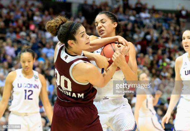 Gabby Williams of the Connecticut Huskies battles for the ball against Dominique Dillingham of the Mississippi State Lady Bulldogs in the first half...