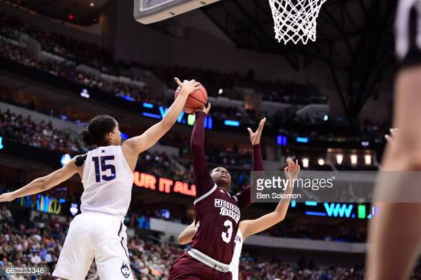 Gabby Williams of the Connecticut Huskies blocks Breanna Richardson of the Mississippi State Lady Bulldogs shot during the semifinal round of the...