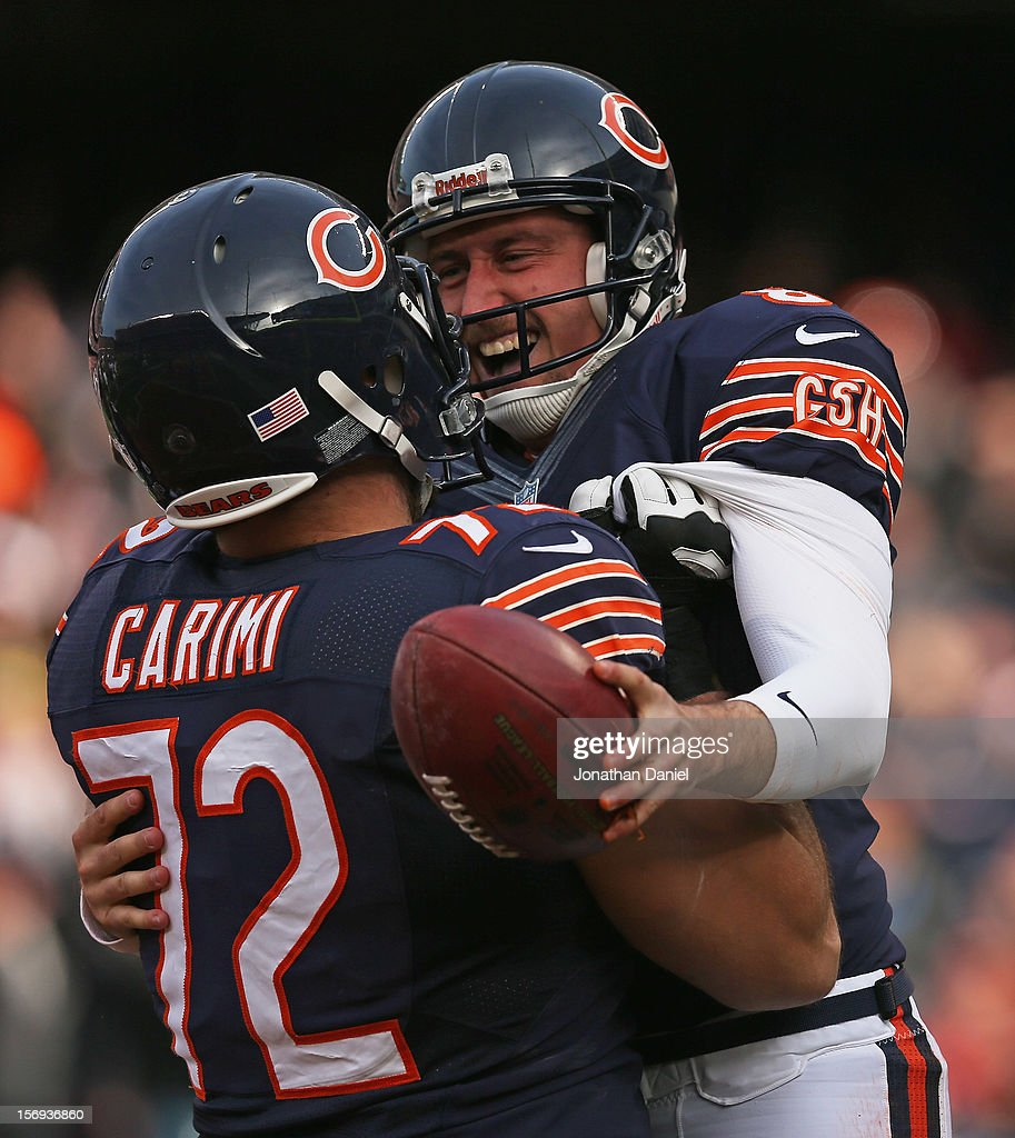 Gabe Carimi #72 of the Chicago Bears lifts up punter Adam Podlesh #8 after Podlesh ran for a two point conversion against the Minnesota Vikings at Soldier Field on November 25, 2012 in Chicago, Illinois.