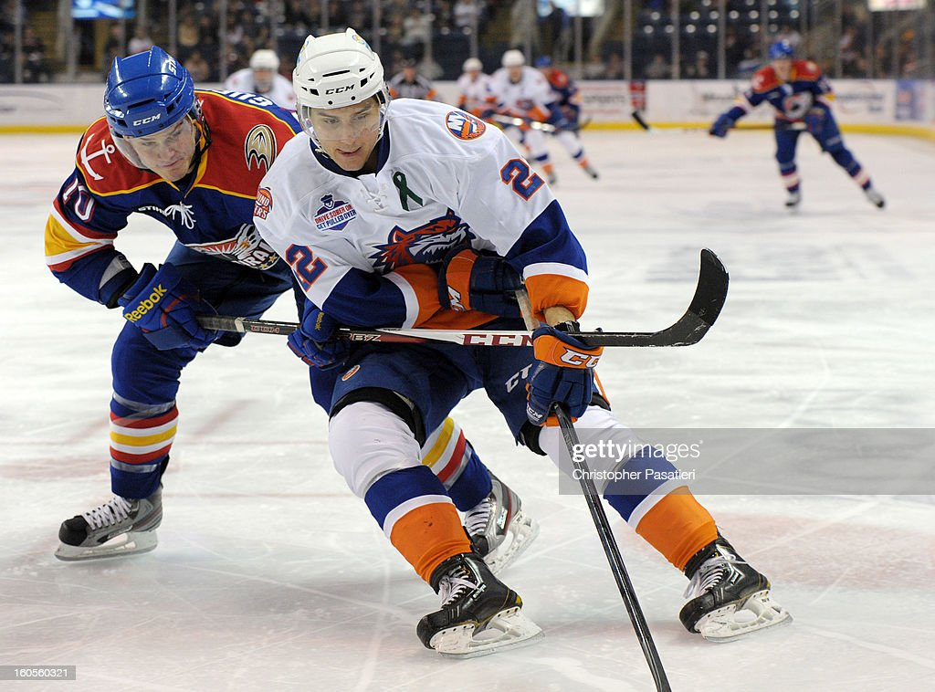 Gabe Guentzel #10 of the Norfolk Admirals gets his stick under Nino Niederreiter #22 of the Bridgeport Sound Tigers as he skates with the puck during an American Hockey League game on February 2, 2013 at the Webster Bank Arena at Harbor Yard in Bridgeport, Connecticut.