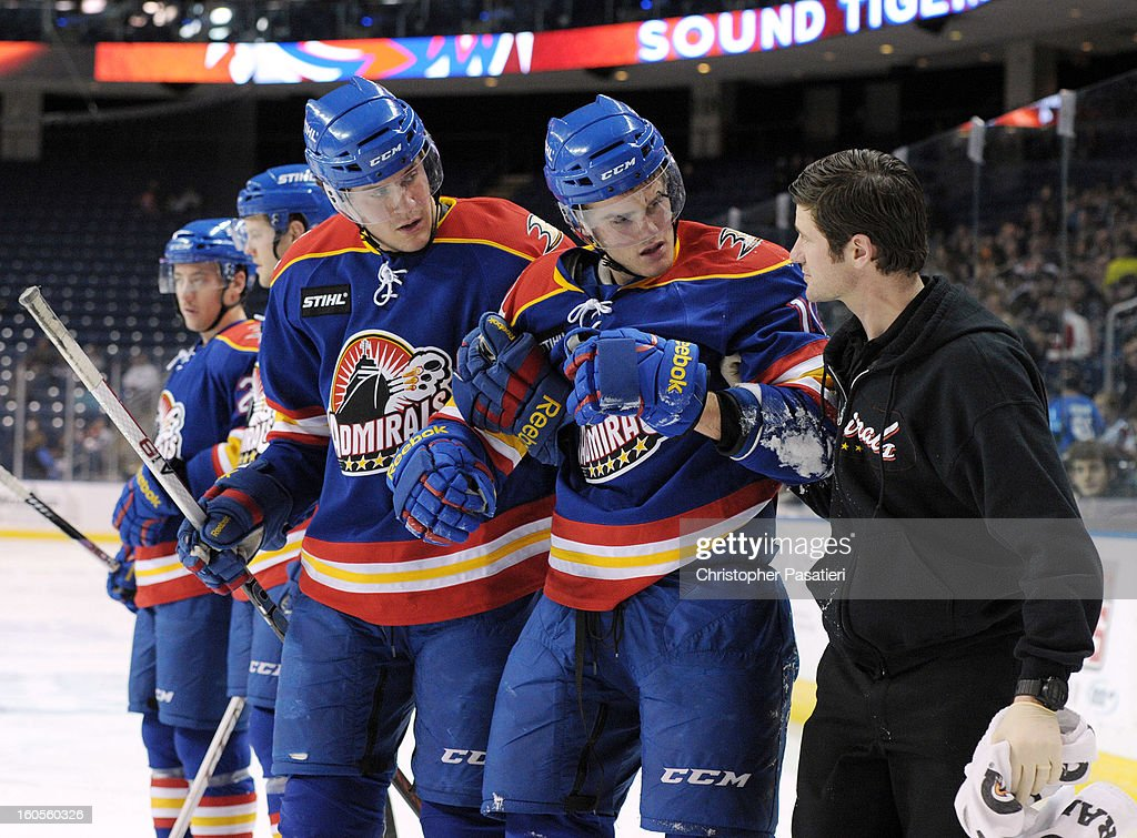 Gabe Guentzel of the Norfolk Admirals has to be helped off the ice after being injured during an American Hockey League game against the Bridgeport...