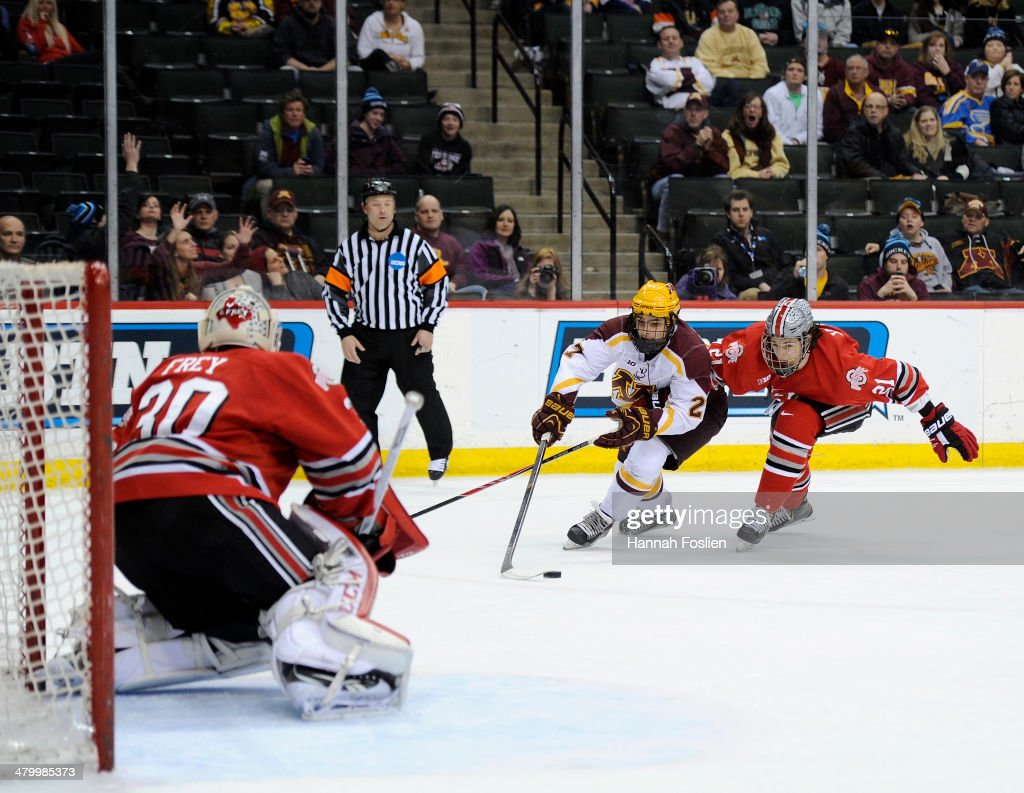 Gabe Guertler #27 of the Minnesota Golden Gophers shoots the puck against Christian Frey #30 and Sam Jardine #21 of the Ohio State Buckeyes during the second period of the semifinal game of the Big Ten Men's Ice Hockey Championship on March 21, 2014 at Xcel Energy Center in St Paul, Minnesota. The Ohio State Buckeyes defeated the Minnesota Golden Gophers 3-1.