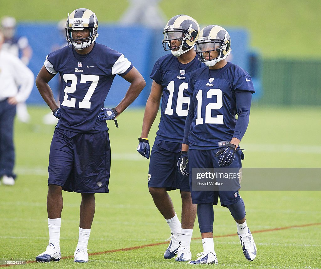 Gabe Loper (27), Emory Blake (16), and Bailey Stedman (12) of the St. Louis Rams wait for their turns at a drill during the 2013 St. Louis Rams rookie camp at Rams Park on May 10, 2013 in Earth City, Missouri.