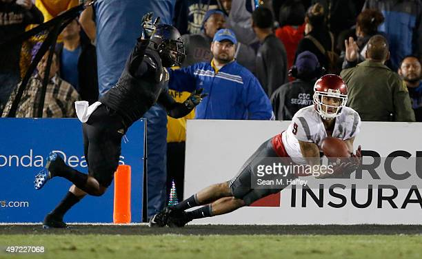 Gabe Marks of the Washington State Cougars catches a pass for a touchdown as Soso Jamabo of the UCLA Bruins defends during the fourth quarter of a...