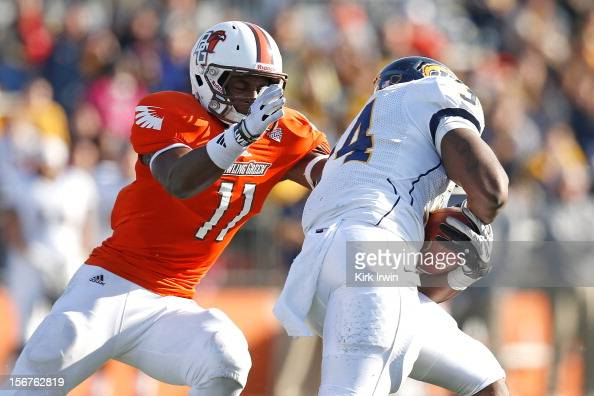 Gabe Martin of the Bowling Green Falcons tackles Trayion Durham of the Kent State Golden Flashes on November 17 2012 at Doyt Perry Stadium in Bowling...