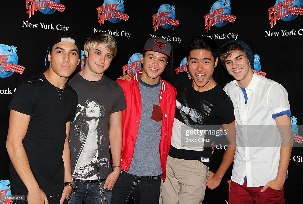 Gabe Morales Dalton Rapattoni Dana Vaughns Cole Pendery and Will Jay of the group IM5 visit Planet Hollywood Times Square on July 29 2013 in New York...