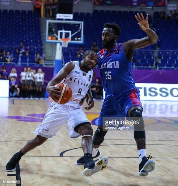 Gabe Olaseni of England and Jonathan Tabu of Belgium vie for the ball during FIBA EuroBasket 2017 Group D match between Belgium and England at Ulker...