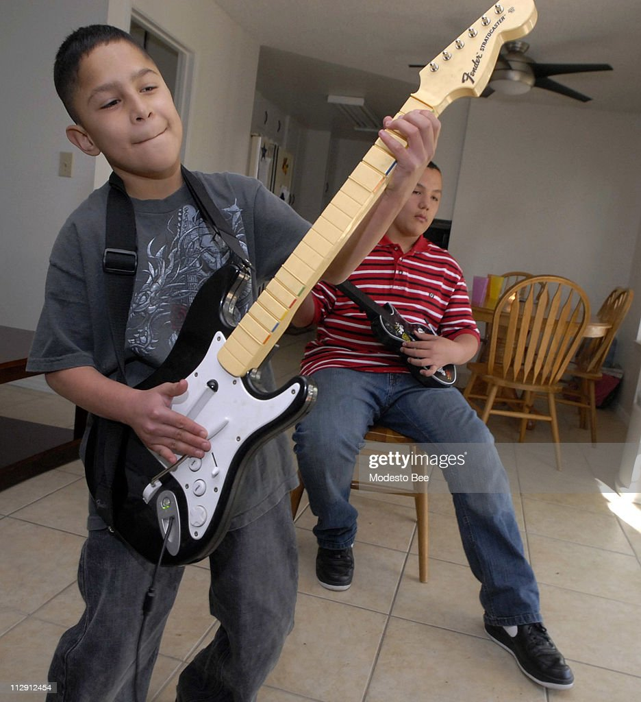 small boy s heart pictures getty images gabe sanchez 12 plays lead guitar as one of his triplet brothers frank