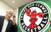 Jack Quirk laughs in the Portland Red Claws office Thursday September 15 while talking with Timothy Oxton of Vinalhaven Oxton was selected out of 785...
