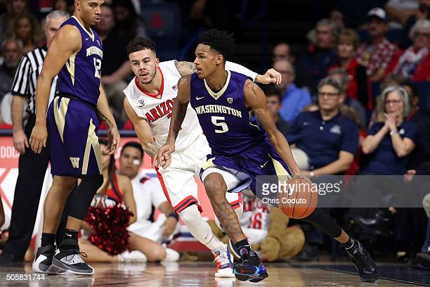 Gabe York of the Arizona Wildcats defends Dejounte Murray of the Washington Huskies during the first half of the college basketball game at McKale...