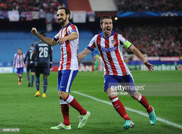 Gabi Fernandez and Juanfran of Club Atletico de Madrid celebrate after Raul Garcia scoring the team's opening goal during the UEFA Champions League...