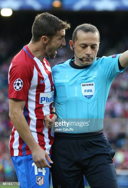 Gabi Fernandez Arenas of Atletico Madrid screams at referee Cuneyt Cakir of Turkey during the UEFA Champions League Semi Final second leg match...