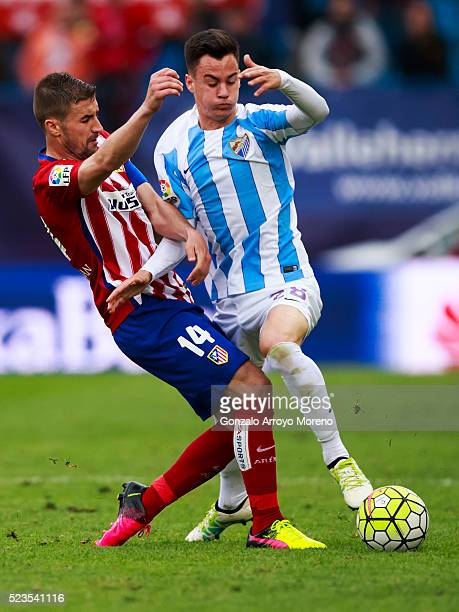 Gabi Fernandez of Atletico de Madrid competes for the ball with Juan Pablo Anor Acosta alias Juanpi of Malaga CF during the La Liga match between...