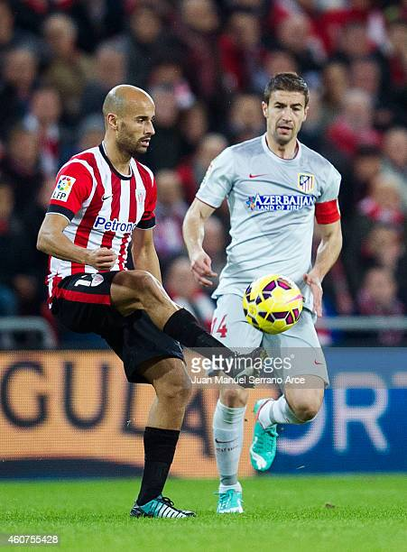 Gabi Fernandez of Atletico de Madrid competes for the ball with Mikel Rico of Athletic Club during the La Liga match between Athletic Club de Bilbao...