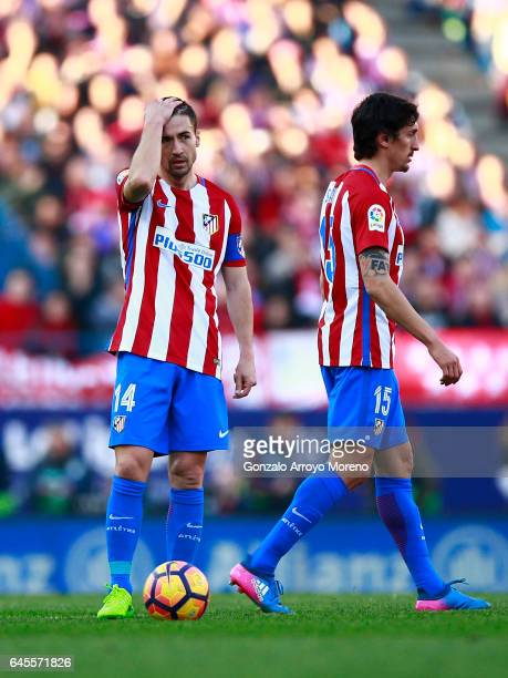 Gabi Fernandez of Atletico de Madrid reacts behind his teammate Stefan Savic during the La Liga match between Club Atletico de Madrid and FC...