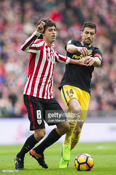 Gabi Fernandez of Atletico Madrid competes for the ball with Ander Iturraspe of Athletic Club during the La Liga match between Athletic Club Bilbao...