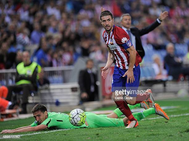 Gabi Fernandez of Club Atletico de Madrid beats Stefan Scepovic of Getafe during the La Liga match between Atletico de Madrid and Getafe at Vicente...