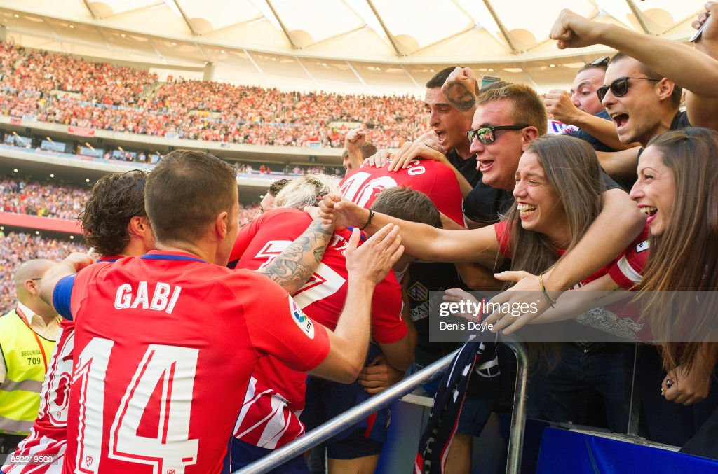 Gabi Fernandez of Club Atletico de Madrid celebrates with fans after his side scored their teamÕs 1st goal during the La Liga match between Atletico Madrid and Sevilla at Wanda Metropolitano on September 23, 2017 in Madrid, Spain.