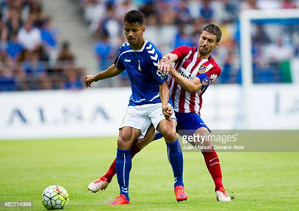 Gabi Fernandez of Club Atletico de Madrid duels for the ball with Allyson of Real Oviedo during a pre season friendly match between Real Oviedo and...
