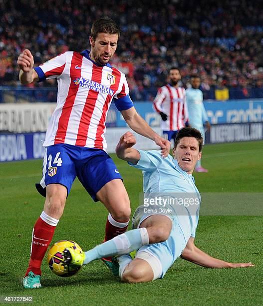 Gabi Fernandez of Club Atletico de Madrid is tackled by Hector Yuste of Granada CF during the La Liga match between Club Atletico de Madrid and...