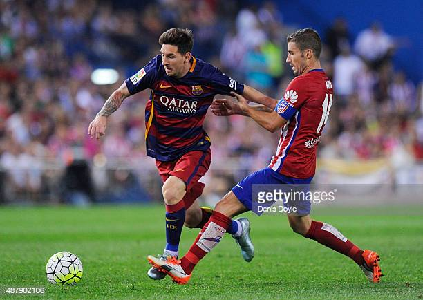 Gabi Fernandez of Club Atletico de Madrid tries to stop Lionel Messi of FC Barcelona during the La Liga match between Club Atletico de Madrid and FC...