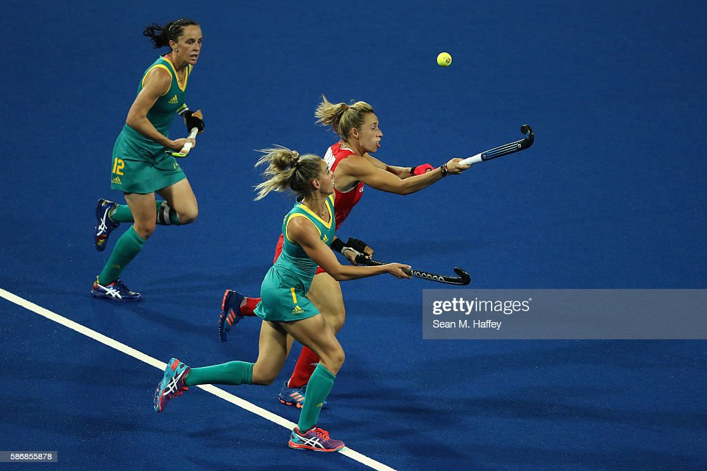 Gabi Nance and Madonna Blyth of Australia chase Susannah Townsend of Great Britain during a Women's Pool B match between Australia and Great Britain...