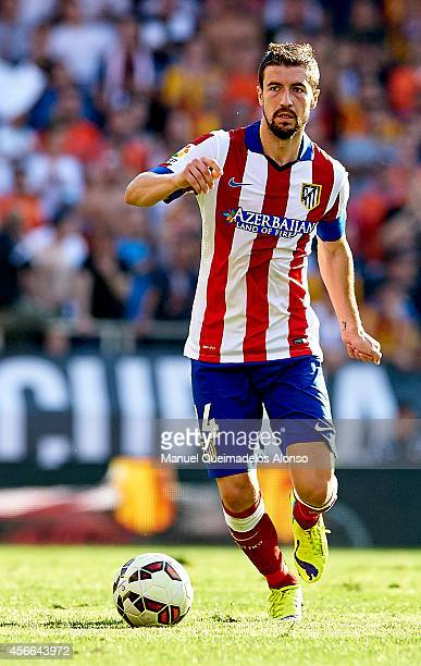 Gabi of Atletico de Madrid runs with the ball during the La Liga match between Valencia CF and Club Atletico de Madrid at Estadi de Mestalla on...