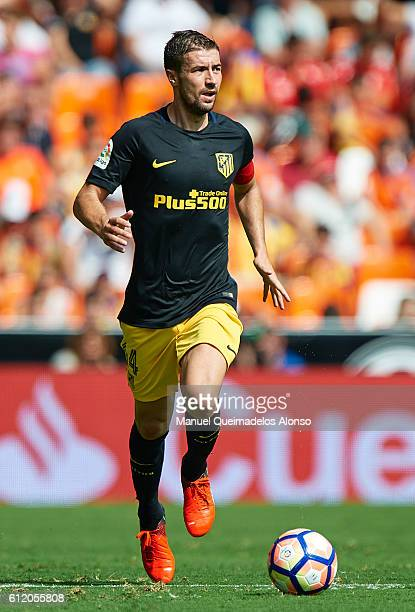 Gabi of Atletico de Madrid runs with the ball during the La Liga match between Valencia CF and Atletico de Madrid at Mestalla Stadium on October 02...