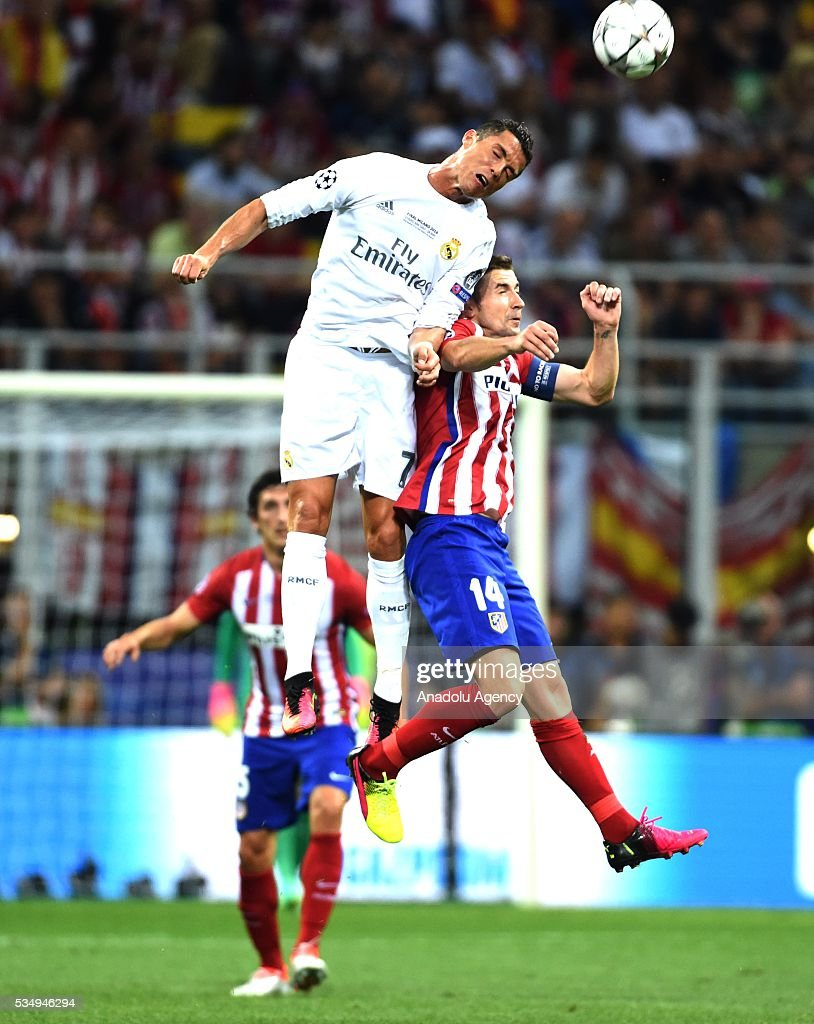 Gabi (R) of Atletico Madrid and Cristiano Ronaldo (L) of Real Madrid vie for the ball during the UEFA Champions League Final between Real Madrid CF and Atletico Madrid at the Giuseppe Meazza Stadium in Milan, Italy on May 28, 2016 in Milan, Italy.