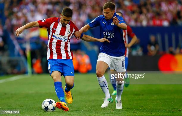 Gabi of Atletico Madrid and Marc Albrighton of Leicester City battle for the ball during the UEFA Champions League Quarter Final first leg match...