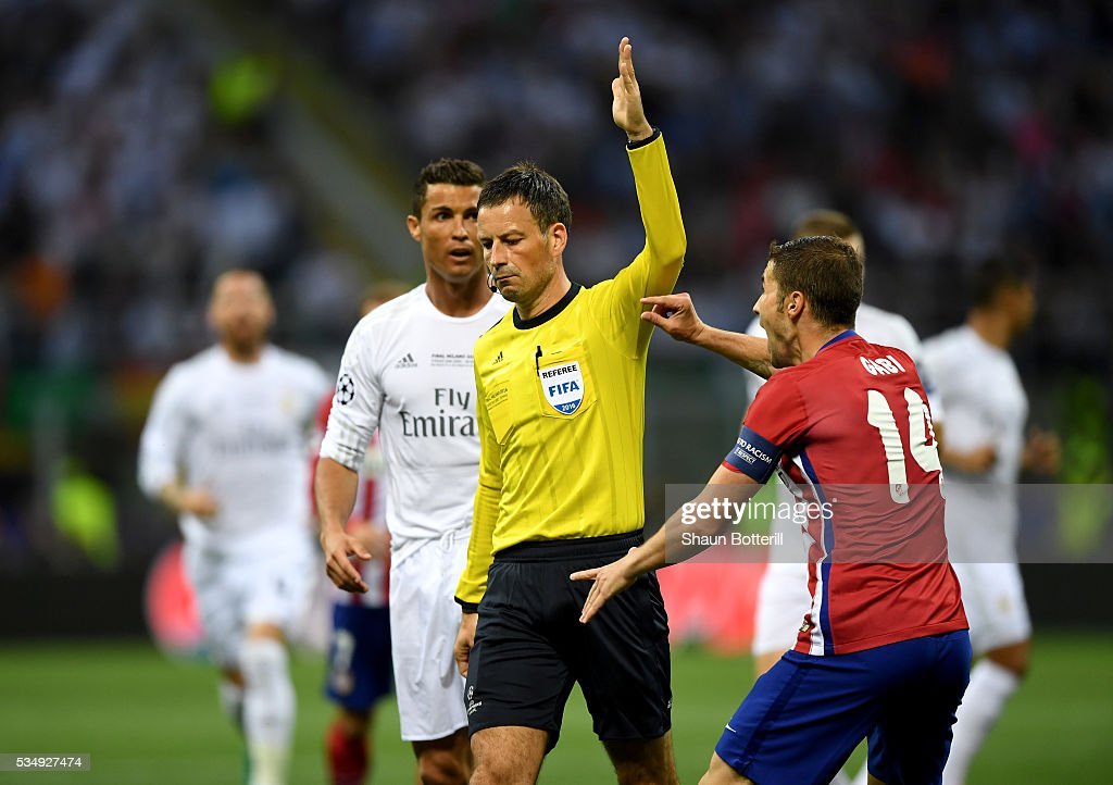 <a gi-track='captionPersonalityLinkClicked' href=/galleries/search?phrase=Gabi+-+Soccer+Player&family=editorial&specificpeople=6912055 ng-click='$event.stopPropagation()'>Gabi</a> of Atletico Madrid argues with the referee <a gi-track='captionPersonalityLinkClicked' href=/galleries/search?phrase=Mark+Clattenburg&family=editorial&specificpeople=2108870 ng-click='$event.stopPropagation()'>Mark Clattenburg</a> during the UEFA Champions League Final match between Real Madrid and Club Atletico de Madrid at Stadio Giuseppe Meazza on May 28, 2016 in Milan, Italy.