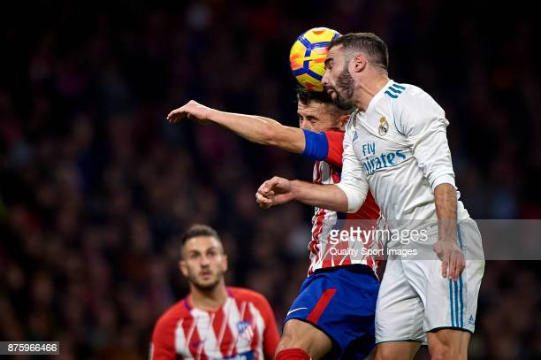 Gabi of Atletico Madrid competes for the ball with Daniel Carvajal of Real Madrid during the La Liga match between Atletico Madrid and Real Madrid at...