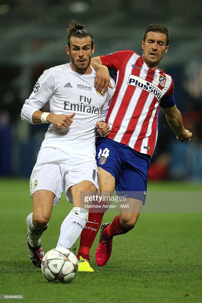 <a gi-track='captionPersonalityLinkClicked' href=/galleries/search?phrase=Gabi+-+Soccer+Player&family=editorial&specificpeople=6912055 ng-click='$event.stopPropagation()'>Gabi</a> of Atletico Madrid competes with <a gi-track='captionPersonalityLinkClicked' href=/galleries/search?phrase=Gareth+Bale&family=editorial&specificpeople=609290 ng-click='$event.stopPropagation()'>Gareth Bale</a> of Real Madrid during the UEFA Champions League final match between Real Madrid and Club Atletico de Madrid at Stadio Giuseppe Meazza on May 28, 2016 in Milan, Italy.