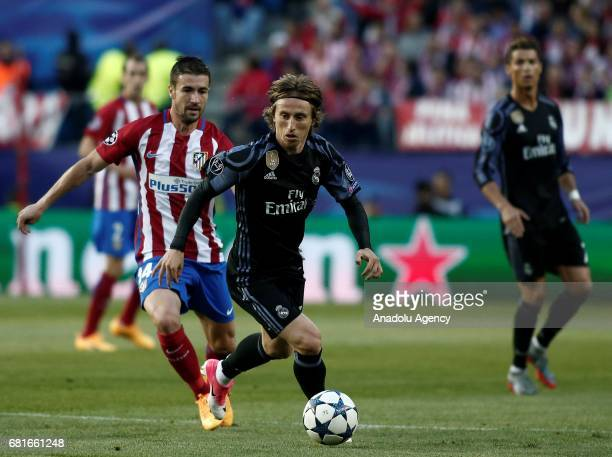 Gabi of Atletico Madrid in action against Luka Modric of Real Madrid during the UEFA Champions League semi final second leg match between Atletico...