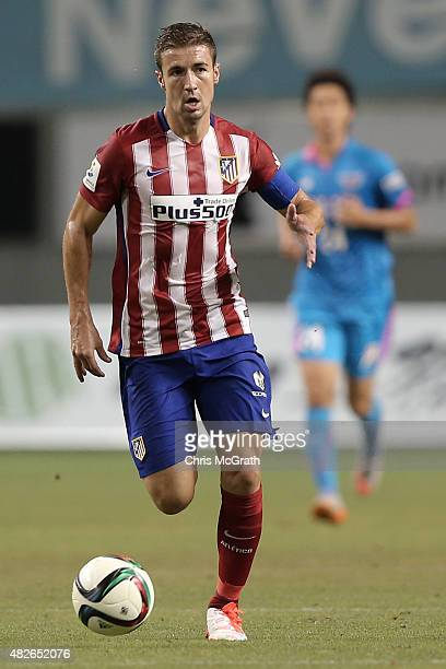 Gabi of Atletico Madrid looks to pass against Sagan Tosu FC during the friendly match between Atletico Madrid and Sagan Tosu FC at Tosu Stadium on...