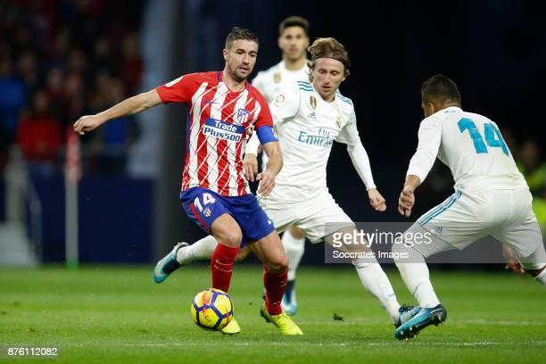 Gabi of Atletico Madrid Luka Modric of Real Madrid during the Spanish Primera Division match between Atletico Madrid v Real Madrid at the Estadio...