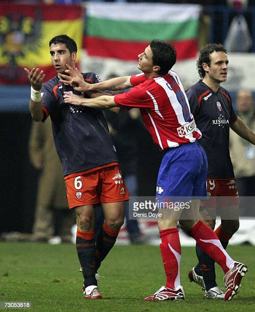 Gabi of Atletico Madrid pushes Raul Garcia of Osasuna after Referee Vicente Lizondo sent off Garcia during the La Liga match between Atletico Madrid...