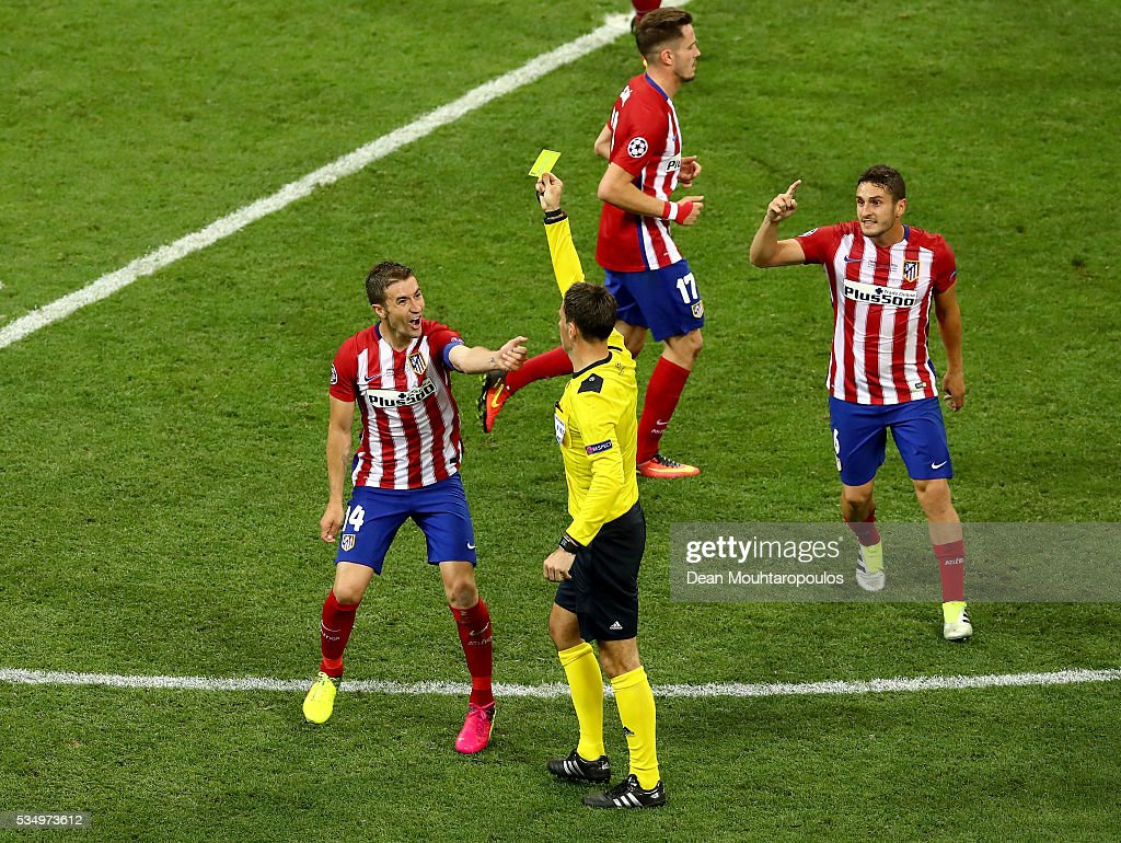 <a gi-track='captionPersonalityLinkClicked' href=/galleries/search?phrase=Gabi+-+Voetballer&family=editorial&specificpeople=6912055 ng-click='$event.stopPropagation()'>Gabi</a> of Atletico Madrid receives a yellow card during the UEFA Champions League Final match between Real Madrid and Club Atletico de Madrid at Stadio Giuseppe Meazza on May 28, 2016 in Milan, Italy.