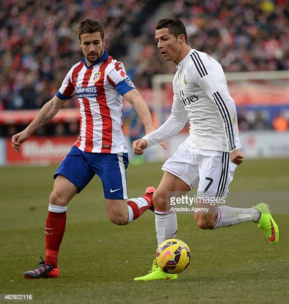 Gabi of Atletico Madrid vies for the ball with Ronaldo of Real Madrid during the Spanish La Liga soccer match between Atletico Madrid and Real Madrid...